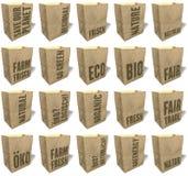 Os sacos de compras de Brown, totalizadores, sacolas, material de papel natural, ecológico, slogan das vendas, cópia, ajustaram E Imagens de Stock Royalty Free