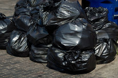 Sacos do lixo empilhados acima Foto de Stock Royalty Free