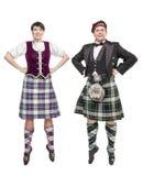 Os Scottish de dança da mulher e do homem dos pares dançam Imagens de Stock Royalty Free