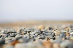 Os seixos na praia de Chipre Imagem de Stock
