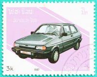 Os selos postais com impresso em Laos mostram o carro Imagem de Stock