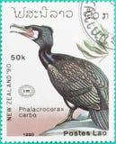 Os selos postais tinham sido imprimidos em Laos Fotografia de Stock Royalty Free