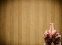 Os smiley felizes do dedo com vintage listram o fundo do papel de parede Foto de Stock Royalty Free
