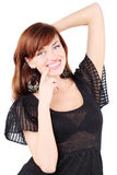 Os sorrisos felizes da menina e tocam em seu queixo Imagens de Stock Royalty Free