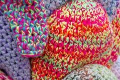 Os tampões coloridos de lãs Imagens de Stock