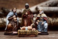 Os três reis que adoram a criança Jesus Fotos de Stock Royalty Free