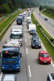 Os veículos que esperam na linha inscrever Gotthard escavam um túnel Imagem de Stock