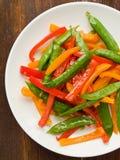 Os vegetais agitar-fritam imagens de stock