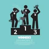 Os vencedores comemoram no pódio Imagem de Stock