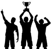 Os vencedores comemoram a vitória do troféu Fotos de Stock