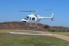 Os voos e os voos charter cênicos de Victoria Falls da mosca do helicóptero de Zambezi Helicóptero Empresa Bell 206 à indústria d fotos de stock royalty free