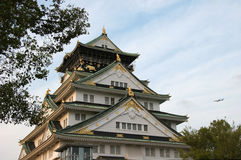 Osaka Castle. Japan, with a jet in the background stock image