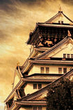 Osaka Castle. With background of yellow grunge paper stock photography