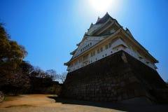 Osaka castle against blue sky and sun Stock Photography