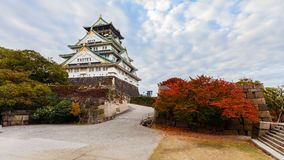 Osaka castle in Autumn. OSAKA, JAPAN - NOVEMBER 18: Osaka Castle in Osaka, Japan on November 18, 2013. One of Japan's most famous and played a major role in the Royalty Free Stock Photography