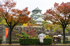 Osaka Castle in Autumn, Fall Tree Leaves and Foliage. Bright Autum colors and orange leaves at the Osaka Castle in Japan. The castle is one of Japan`s most stock images