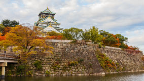 Osaka castle in Autumn. OSAKA, JAPAN - NOVEMBER 18: Osaka Castle in Osaka, Japan on November 18, 2013. One of Japan's most famous and played a major role in the Royalty Free Stock Photos