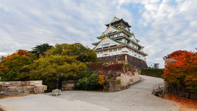 Osaka castle in Autumn. OSAKA, JAPAN - NOVEMBER 18: Osaka Castle in Osaka, Japan on November 18, 2013. One of Japan's most famous and played a major role in the Stock Photo
