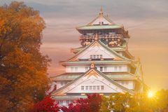 Osaka castle during autumn in Japan. Osaka castle beautiful landmark of Osaka, Japan during autumn with beauti sky sunset and sun flare royalty free stock images