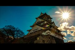 Osaka Castle with beautiful sun stock photo