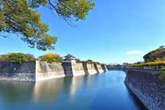 Osaka Castle with blue skies surrounded by water, Japan Royalty Free Stock Images
