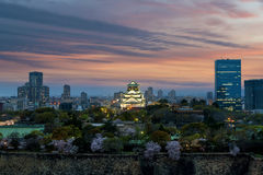 Osaka castle with cherry blossom and center business district in. Background at Osaka, Japan. Japan spring beautiful scene Royalty Free Stock Images