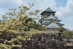 Osaka Castle, Japan. Osaka Castle is a Japanese castle in Chūō-ku, Osaka, Japan. The castle is one of Japan`s most famous landmarks and it played a major stock photos