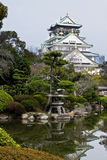 Osaka castle. A Japanese garden with Osaka castle in the background Royalty Free Stock Image