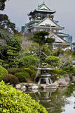 Osaka Castle. A Japanese garden with the Osaka castle in the background Royalty Free Stock Photography
