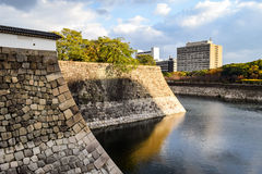Osaka Castle moat and city buildings Royalty Free Stock Photo