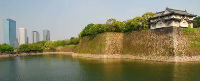 Osaka castle moat and skyscrapers Stock Photography