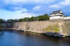 Osaka Castle moat and stonewall. Osaka Castle moat and stone wall on overcast day Royalty Free Stock Image