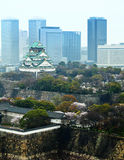 Osaka castle with modern building background Royalty Free Stock Images