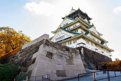 Osaka Castle in Osaka with autumn leaves. Royalty Free Stock Photography