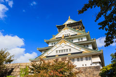 Osaka Castle in Osaka with autumn leaves, Japan. Royalty Free Stock Image