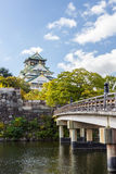 Osaka Castle in Osaka with autumn leaves, Japan. Stock Images