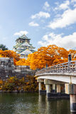 Osaka Castle in Osaka with autumn leaves, Japan. Royalty Free Stock Photos