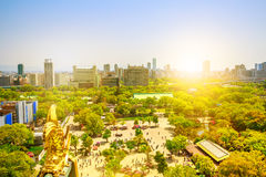 Osaka Castle Park cityscape. Looking down on Osaka Castle Park at sunset light from Osaka Castle. Golden dragon fish statue or Shachihoko at roof top of Osaka Royalty Free Stock Image