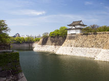 Osaka Castle's Gate. White Turret of Osaka Castle and the moat defending the inner bailey Stock Photography