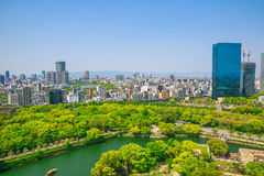 Osaka Castle skyline. Aerial view of moat around castle park, Osaka business district and spectacular mountains surrounding the city from Osaka Castle, one of stock photos