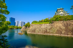 Osaka Castle and skyline. Wall and moat around Osaka Castle from Nishinomaru Garden and skyscrapers of Osaka Business Park on background. Osaka Castle is one of Royalty Free Stock Image