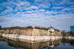 Osaka Castle stone wall with water reflect below royalty free stock images
