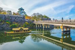 Osaka Castle, a tourist boat in the moat. The castle is one of Japan`s most famous landmarks and it played a major role in the unification of Japan during the stock images