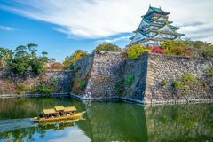 Osaka Castle, a tourist boat in the moat. The castle is one of Japan`s most famous landmarks and it played a major role in the unification of Japan during the stock photography