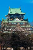 Osaka Castle. View of Osaka Castle from across the moat, through the trees in the winter, morning sunlight Stock Photos
