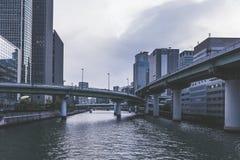 Osaka city modern downtown building near the river stock photo