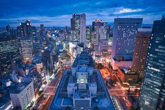 Osaka city skyline - asia modern business city, cityscape birds eye view in evening. Shot in Osaka ekimae daisan third building, Osaka, Japan stock image