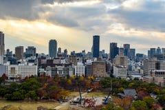 Osaka cityscape with overcast sky. Osaka city skyline with a park in the foreground Stock Photo