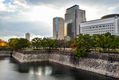 Osaka cityscape with overcast sky. Osaka Museum of History at the edge of Osaka Castle moat Royalty Free Stock Photo