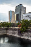 Osaka cityscape with overcast sky. Osaka Museum of History at the edge of Osaka Castle moat Royalty Free Stock Photography